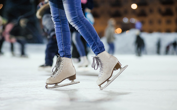 a girl ice skating on an ice rink