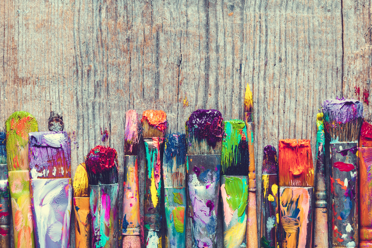 row of colorful paint brushes