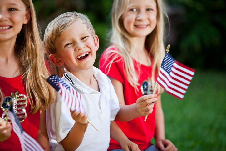 kids holding usa flags